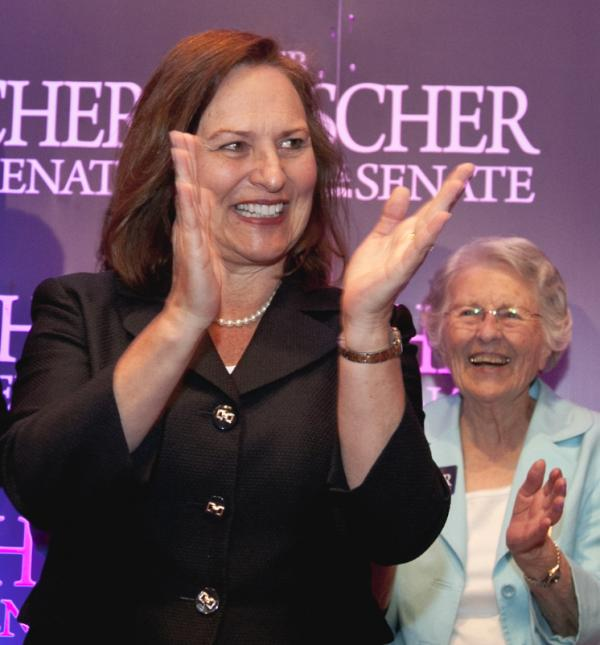 Nebraska state Sen. Deb Fischer applauds supporters at her election party Tuesday in Lincoln, Neb. At right is Fischer's mother, Florence Strobel.