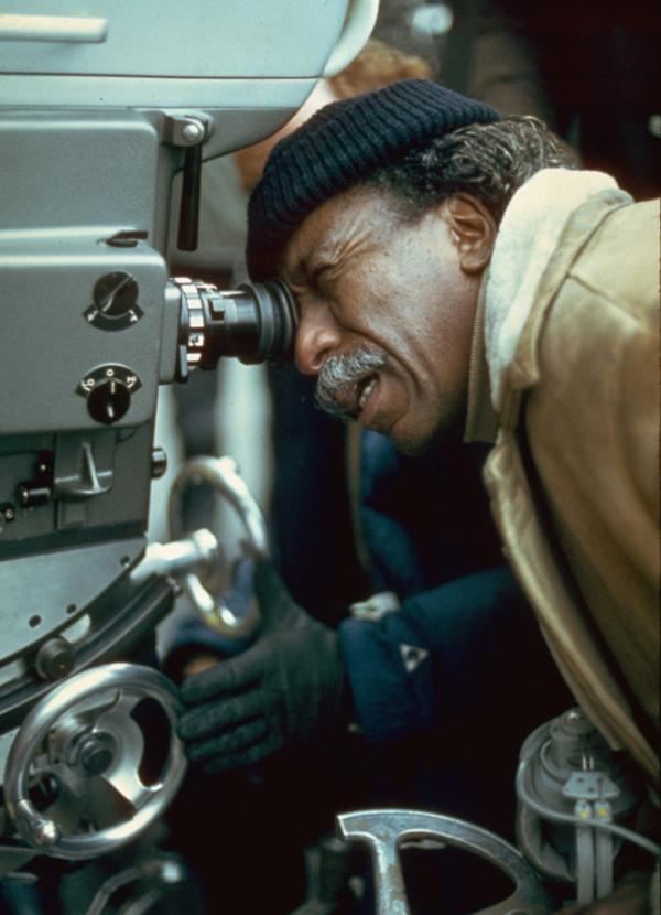 American film director and photographer Gordon Parks on the set of a film, circa 1971.