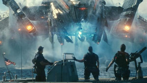 Beast (John Tui), Hopper (Taylor Kitsch) and Raikes (Rihanna) are stunned by the appearance of invading alien forces in the motion picture adaption of the, yes, board game <em>Battleship.</em>