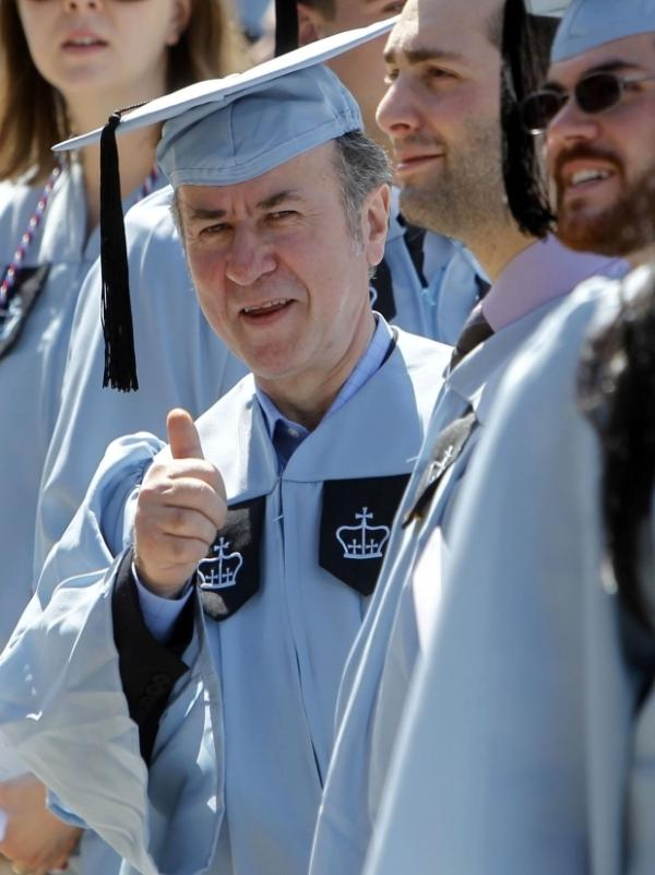 Filipaj give a thumbs-up during the Columbia University School of General Studies graduation ceremony.