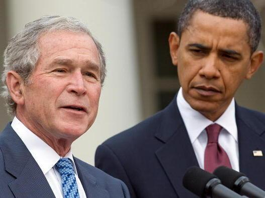Former President George W. Bush, standing with President Obama, speaks about relief efforts in Haiti in January 2010.