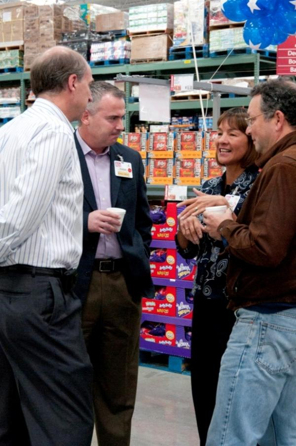 Laura Sen talks with team members at the opening of the Northborough, Mass., club in September 2011.