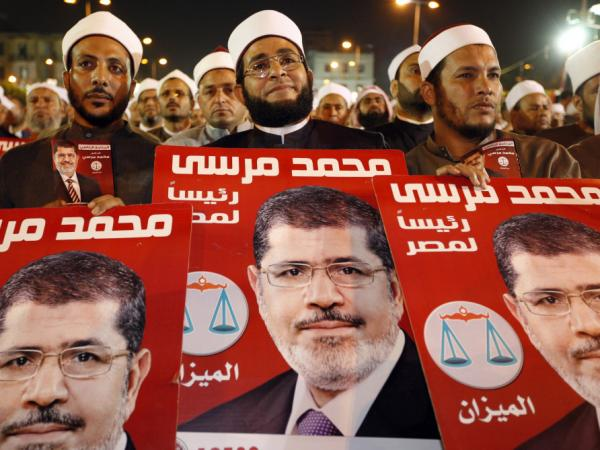 Several hundreds imams listen to Morsi at a rally in Cairo on Sunday.