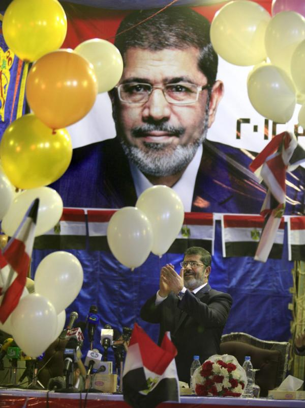 Mohammed Morsi, the Muslim Brotherhood's presidential candidate, waves to his supporters during a campaigning conference in Cairo last month.