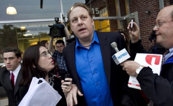 Former Boston Red Sox pitcher Curt Schilling had to push through a mob of reporters on Monday after meeting with Rhode Island officials to discuss the finances of his troubled video game company and ask for more state help.