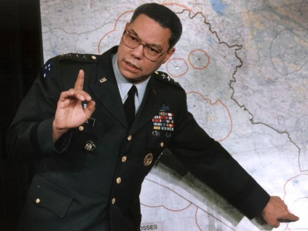 Colin Powell, then chairman of the U.S. Joint Chiefs of Staff under George H. W. Bush, makes a point about the entrenched Iraqi troops in Kuwait during a briefing at the Pentagon in January 1991.