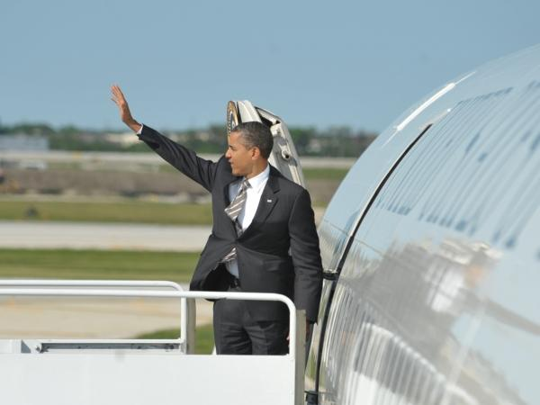 President Barack Obama boards Air Force One at Chicago's O'Hare airport on May 21, 2012. The president has gone on the attack about his opponent's time at Bain Capital.