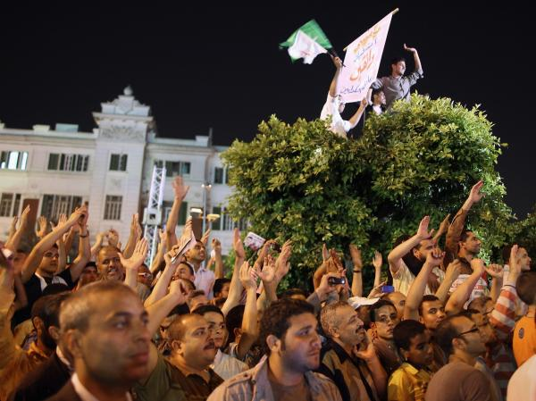 Supporters of the Muslim Brotherhood's presidential candidate Mohamed Morsy cheer at a final campaign rally on May 20, 2012 in Cairo, Egypt. Sunday was the final day of campaigning ahead of the first presidential election in the post-Mubarak era.