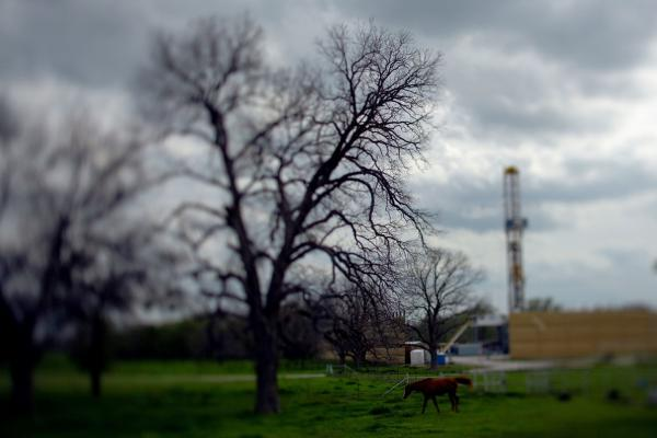 A drilling rig (right) marks the spot of an upcoming frack.