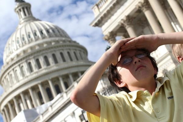 Schoolchildren on a tour watch as the shuttle flies over the U.S. Capitol.