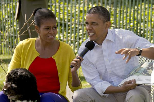 <b>Wild Thing:</b> Obama growls as he reads <i>Where the Wild Things Are</i> to children at this year's White House Easter Egg Roll.