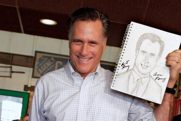<b>Spittin' Image:</b> Romney holds up a sketch drawn by a supporter during a campaign stop in Rockford, Ill., in March.