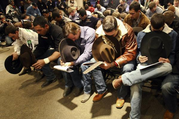 Bull riders say a prayer during a meeting before the start of the first night of competition at the 2007 Ford Trucks Professional Bull Riders series at Madison Square Garden.