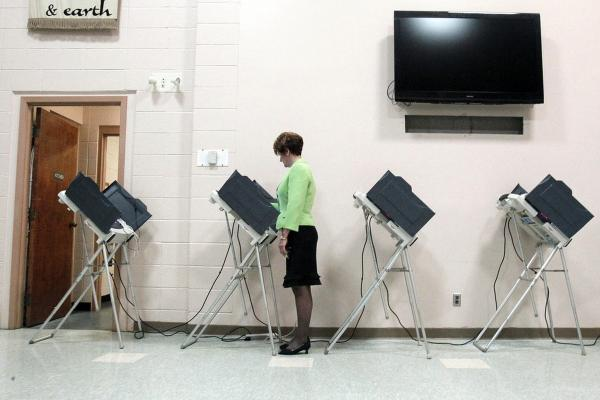 A woman votes in Madison, Miss. The state plays an unaccustomed high-profile role in the GOP presidential nomination.
