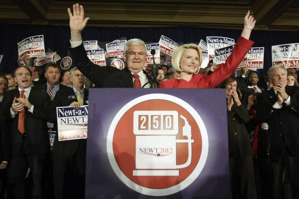 Newt Gingrich and his wife, Callista, wave to supporters at an event in Atlanta after he was declared the winner of the Georgia primary.
