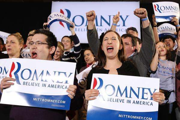 Romney supporters celebrate during a primary night gathering on Tuesday in Boston.