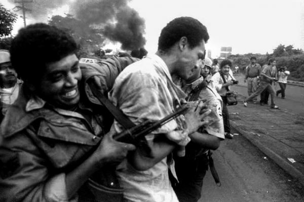 A man is arrested by a policeman armed with an AK-47 after violent clashes erupted during a 1993 general transportation strike in Managua, Nicaragua.