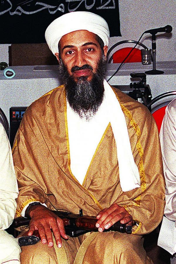 An undated photo of Osama bin Laden shows him with an AK-47 in his lap.