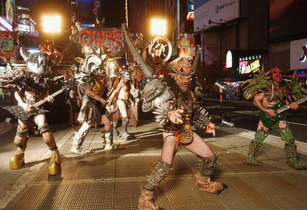 Mask-wearing can blur into full-time theatricality. Legendary heavy metal band GWAR films a video for their new album <i>War Party</i> in Times Square in New York.