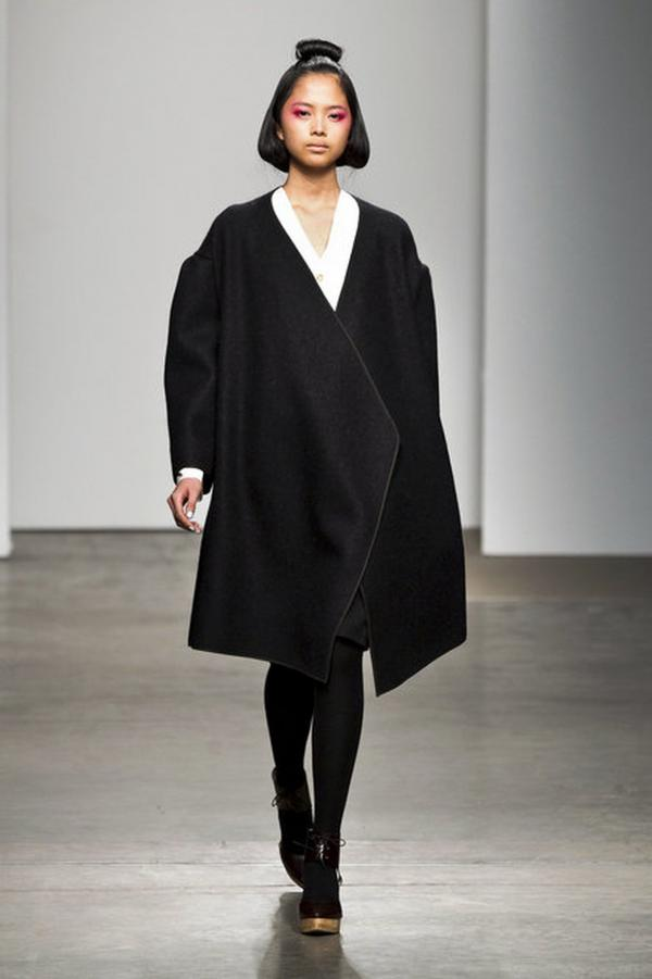 "Coats might seem an obvious choice for a fall/winter show, but they had fallen out of favor for a few years. Now, designers are returning to the coat as a staple, Singer explains — ""the idea that somehow winter is again upon us."" Above, a coat with an exaggerated shoulder at the A Detacher show."