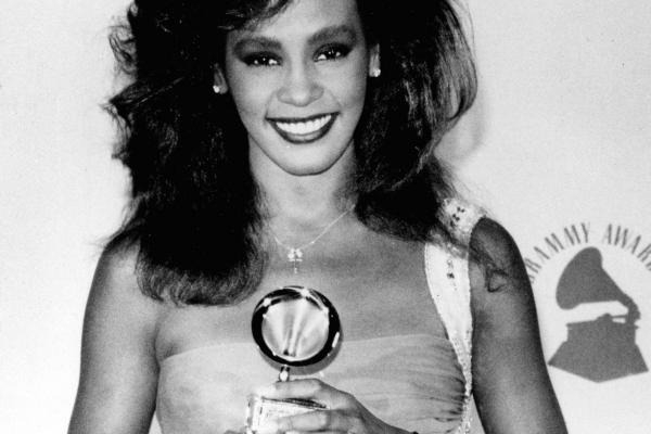 Houston poses with her Grammy backstage at the Grammy Awards in 1986. Houston won Best Female Pop Vocal Performance.