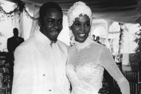 Houston poses with Bobby Brown during their wedding in 1992. Both ended up in court on drug charges at various times during their marriage, which ended in 2007.