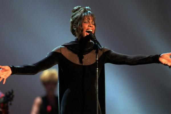 Houston performs at the 1994 American Music Awards in Los Angeles. Starring in both the movie <i>The Bodyguard</i> and its soundtrack, the vocalist swept the awards.