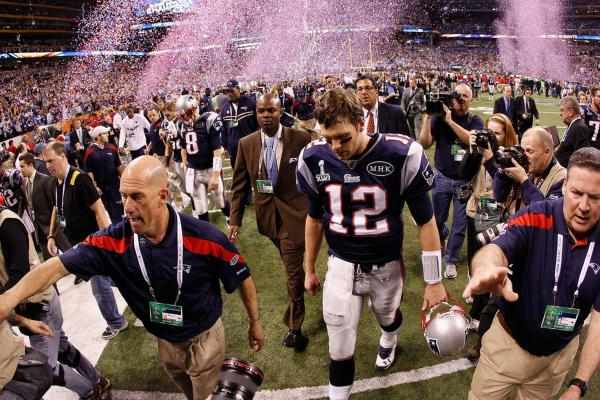Patriots quarterback Tom Brady walks off the field.
