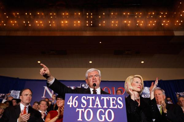 "Newt Gingrich addresses his supporters at a primary night rally in Orlando, with his wife, Callista. Gingrich tells supporters: ""I pledge to you my life, my fortune and my sacred honor. This is about America."""