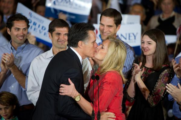 Romney kisses his wife during a rally at his election night headquarters in Tampa. Romney placed first followed by Newt Gingrich, Rick Santorum and Ron Paul.