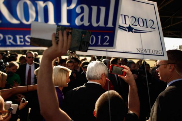 Gingrich and his wife, Callista, campaign outside a polling place in Windermere.