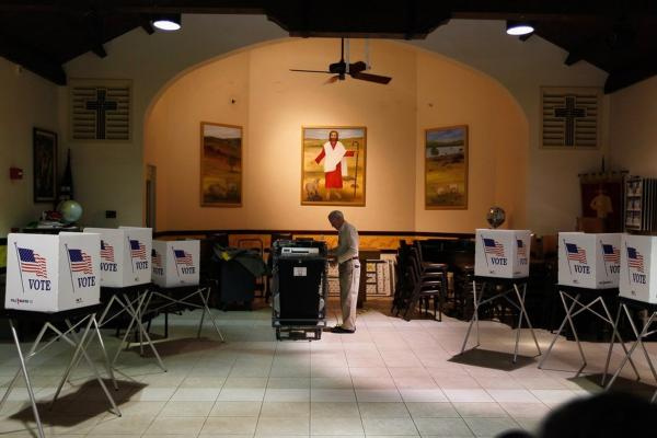Ray Roy sets up a polling station in Tampa on primary day, before voters arrive.