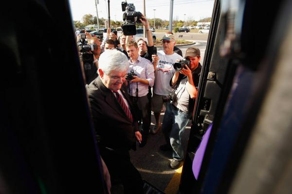 Newt Gingrich boards his bus after visiting his campaign headquarters in Lakeland.