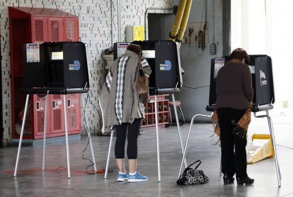 Voters cast their ballots at a fire station in Coral Gables.