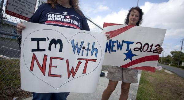 Two supporters of Newt Gingrich stand outside a Hallendale polling center.
