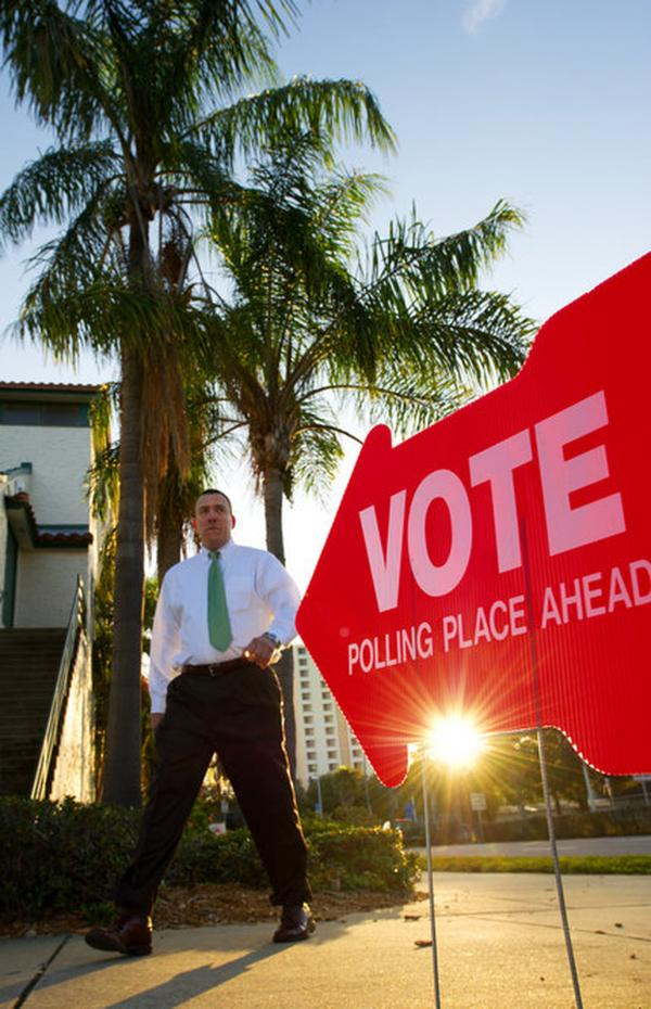 A primary voter walks from his polling precinct at the Coliseum in St. Petersburg.