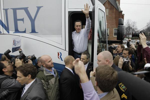 Romney waves from his campaign bus after making a stop at Tommy's Country Ham House in Greenville.