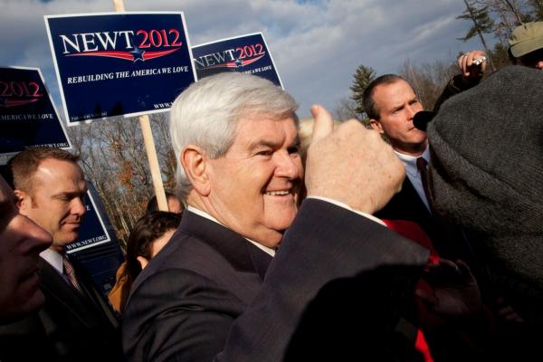 Newt Gingrich greets supporters outside Bedford High School in Bedford.