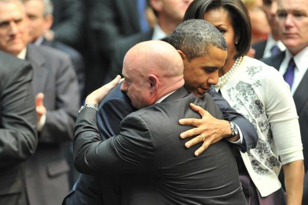 "President Obama hugs Kelly during a memorial service, ""Together We Thrive: Tucson and America,"" at the McKale Memorial Center in Tucson on Jan. 12."