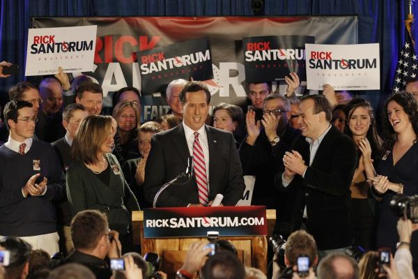 Rick Santorum addresses supporters at his caucus party in Johnston.