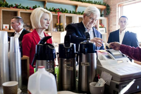 Newt Gingrich and his wife, Callista Gingrich, buy ice cream and coffee at Elly's Tea in Muscatine.