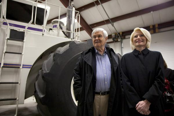 Newt Gingrich and his wife Callista take a tour of the Heartland Acres Agribition Center during a campaign stop Monday in Independence, Iowa.