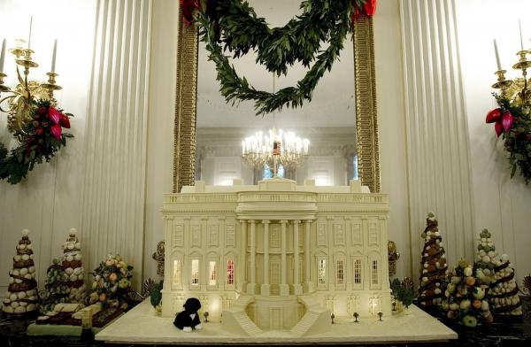"""Shine, Give, Share"" is the theme for the Obama family's third Christmas in the White House. This year, a total of 37 Christmas trees and a 400-pound White House made of gingerbread, white chocolate and marzipan decorate the mansion."