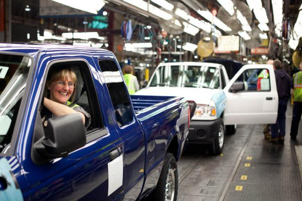 St. Paul resident Lois Neisen drives a Ranger truck off the line after workers inspected that the vehicle's hood, doors and gas cap. Neisen has worked at the Ford plant for 21 years. Her husband retired from the plant, and her son also worked at there for a time.