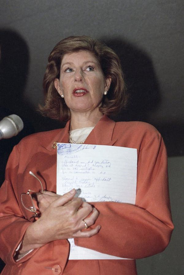 "NPR's Nina Totenberg meets with reporters on Capitol Hill on Feb. 25, 1992, after refusing to identify to Senate special counsel Peter E. Fleming Jr. the sources who told her about the sexual harassment allegations against Thomas. Totenberg refused to cooperate in part because of ""personal honor."""