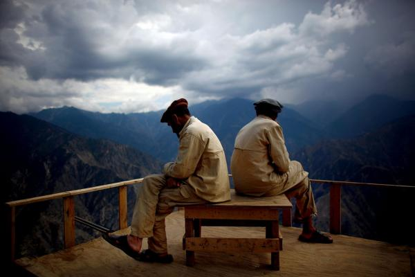 Afghan Security Guards look over the Kunar river valley.