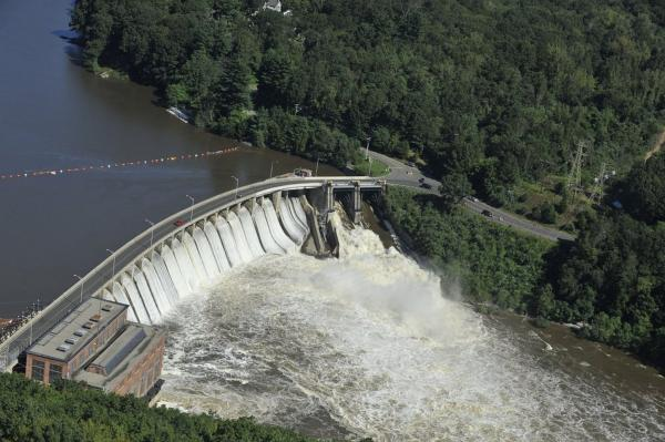 In the aftermath of Tropical Storm Irene, water from the Housatonic River rushes through the Stevenson Dam in Monroe, Conn., on Monday. The rain dumped by the storm pushed three rivers in Connecticut to moderate flood stage, and some are expected to reach their highest level today.