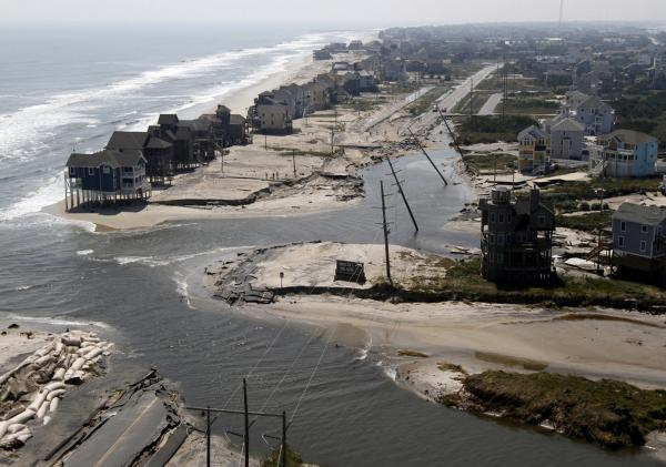 A road is flooded in Hatteras Island, N.C., on Sunday after Hurricane Irene swept through the area, cutting the roadway in five locations.