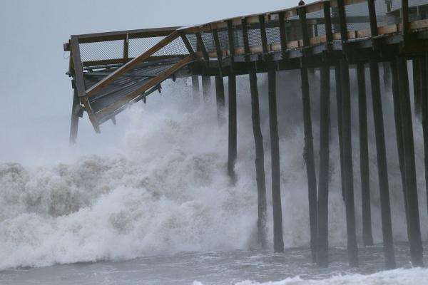 Large waves pound a pier Sunday morning in Ocean City, Md.