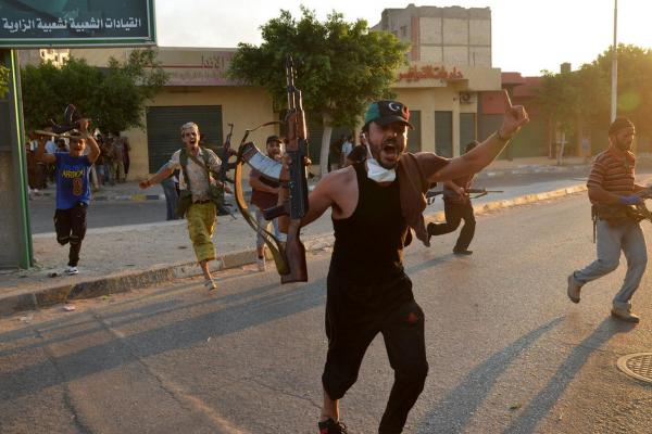 Libyan rebels celebrate after gaining positions against regime forces in Zawiya on Aug.19.